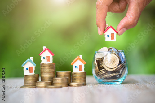 Photo  Concept of Saving money for real estate with buying a new home and loan