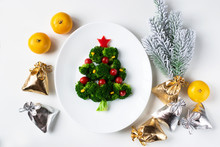 Christmas Edible Tree Made From Broccoli, Tomato And Corn On A White Plate. Christmas Card With Gifts And Dietary Salad.