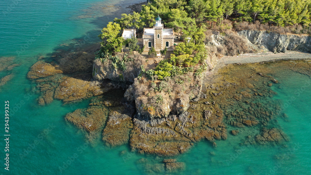 Fototapeta Aerial drone photo of iconic lighthouse built in small islet in famous city of Halkida or Chalkida with clear water seascape and beautiful sky - clouds, Evia island, Greece