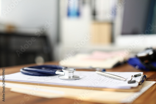Fotografia, Obraz Stethoscope head lying at worktable over patient medical history