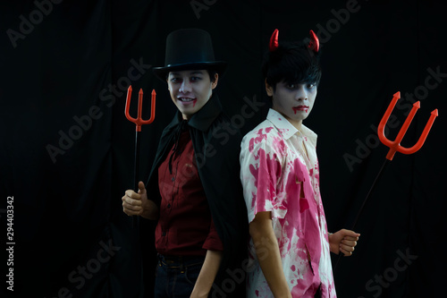 Photo Portrait of  two young ghost boys. Halloween concept.