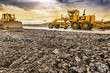 canvas print picture - Excavator to level and smooth the land in the construction of a road