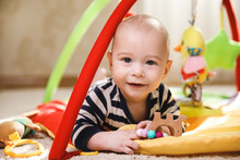Cute  Baby Is Playing On The Activity Mat