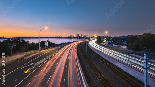 Fotografie, Obraz Traffic on city road during sunset in Perth, WA Australia