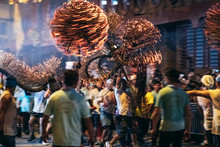 Tai Hang Fire Dragon Dance - People Performing The Dance By Holding The Body Of The Dragon, Dragon Ball And Dance Through The Street