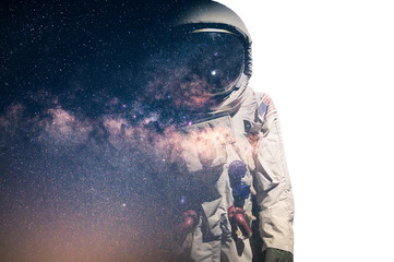 The double exposure image of the astronaut's suit overlay with the milky way ...