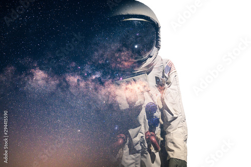 The double exposure image of the astronaut's suit overlay with the milky way galaxy image. the concept of imagination, technology, future, and gaming.