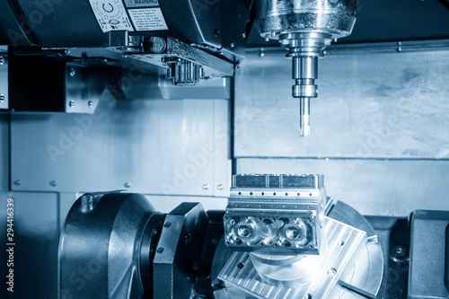 Fotomural  The 5-axis CNC milling machine  cutting the sample of aluminium engine parts by solid ball endmill tools