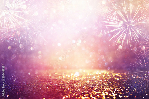 Cuadros en Lienzo  abstract gold, purple and silver glitter background with fireworks