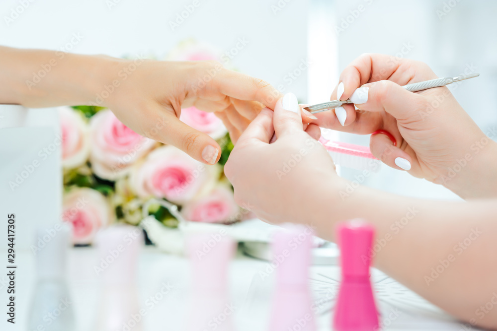 Fototapety, obrazy: Woman having a manicure