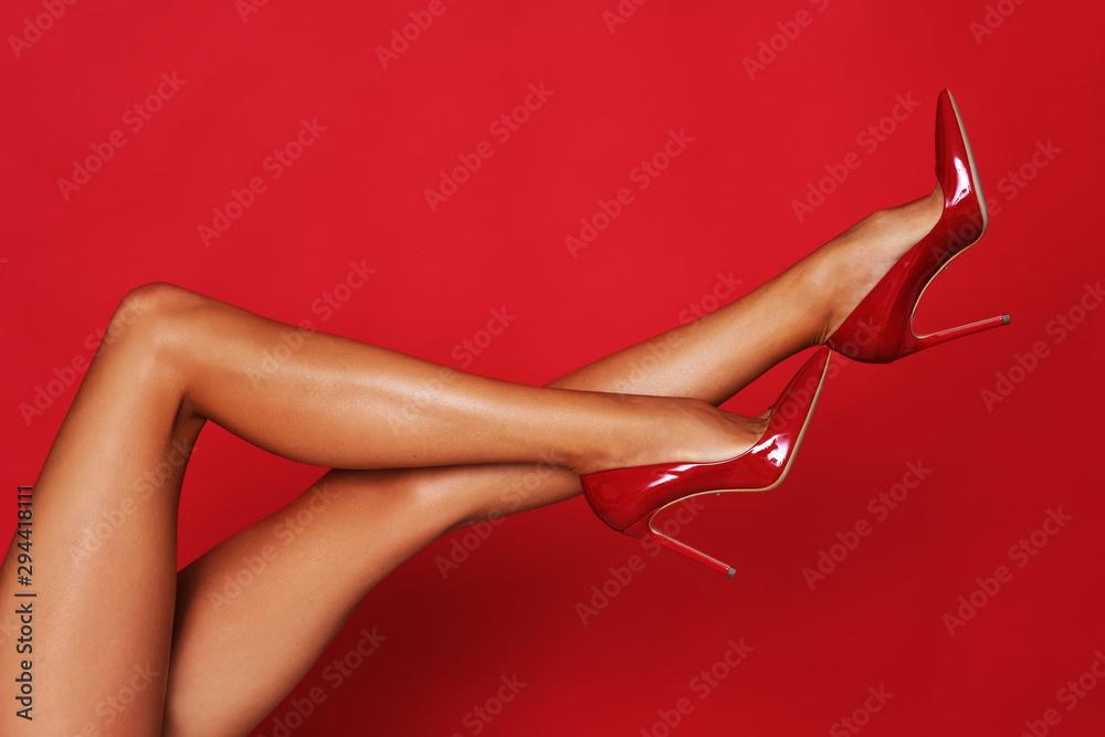Fototapeta Long, slim legs in high heels.