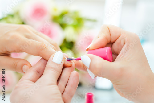 Poster Manicure Experienced nail technician applying nail color