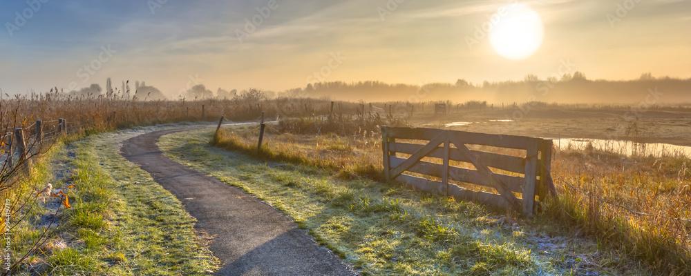 Fototapety, obrazy: Gate in misty agricultural landscape