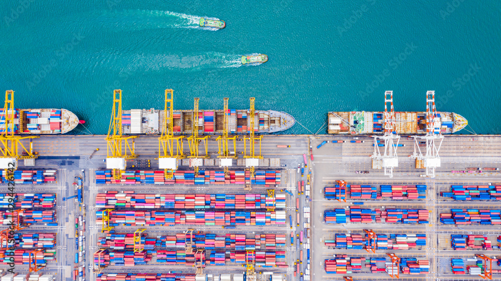 Fototapeta Top view of Deep water port with cargo ship and containers. It is an import and export cargo port where is a part of shipping dock and export products worldwide