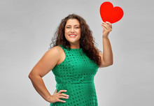 Valentine's Day, People And Love Concept - Happy Woman In Green Dress Holding Red Heart Over Grey Background