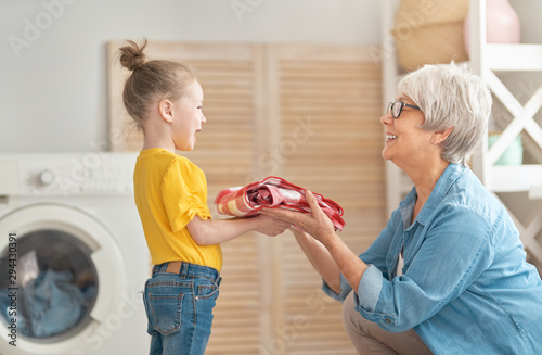 Fotomural  grandma and child are doing laundry