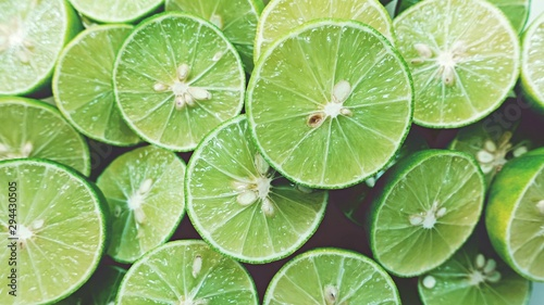 Lime Background. Close up shot of limes. Selective Focus of sliced lime. - 294430505