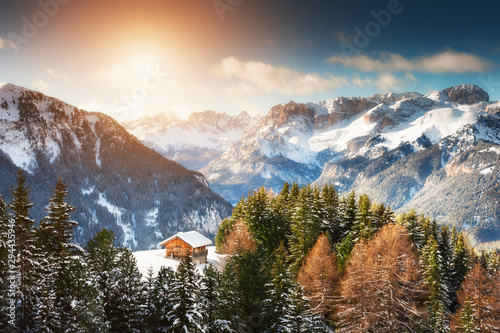 Recess Fitting Alps Wooden house in winter mountains at sunset. Ski resort in Dolomite Alps. Val Di Fassa, Italy. Beautiful winter landscape
