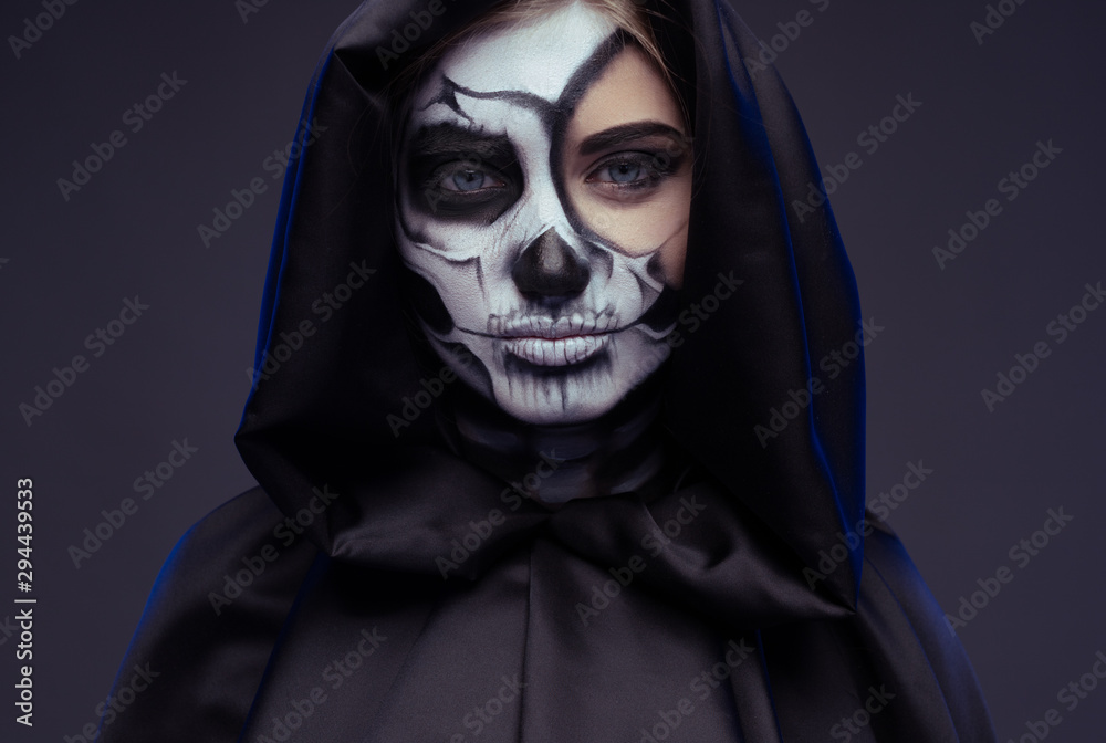Fototapeta Pensive female with Halloween makeup