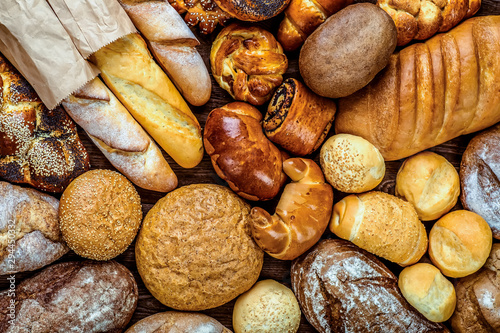 Fototapeta Fresh fragrant bread on the table. Food concept obraz