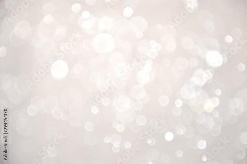 Obraz na plátně Abstract bokeh lights with soft light background. Blur wall.