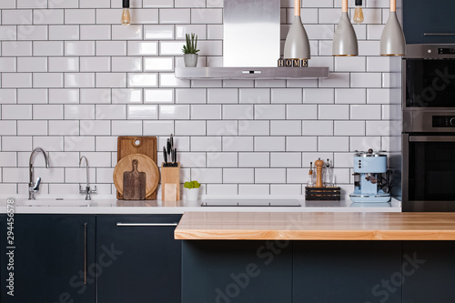 Fotomural Kitchen with white tiles and dark furniture