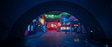 Street of a futuristic city, starting with an arch in a tunnel. Photorealistic 3D illustration. Night scene with neon lighting. City landscape in the style of cyberpunk.