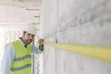 Architect Metering A Wall At C...