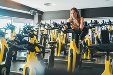 Woman In Spinning Class In Gym