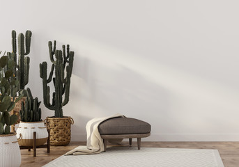 Boho-style interior with leather pouf and cacti
