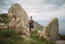 Trail Runner In Coastal Landsc...