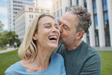 Happy Mature, Couple Kissing In The City