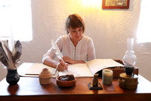 Woman Writing With Quill Pen
