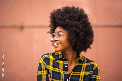 young african american woman with afro and glasses looking away