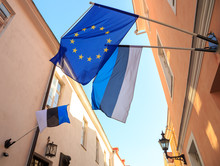 Flag Of European Union (EU) And National Flags Of Estonia, Waving And Hanging, In The Old Town Of Tallinn.