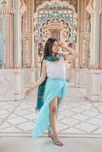 Woman Wearing Teal Skirt
