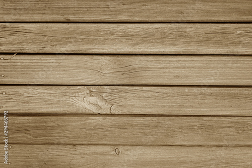 Old grungy wooden planks background in brown color.