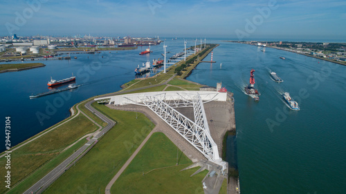 Foto auf Leinwand Rotterdam Aerial picture of Maeslantkering storm surge barrier on the Nieuwe Waterweg Netherlands it closes if the city of Rotterdam is threatened by floods and is one of largest moving structures on earth