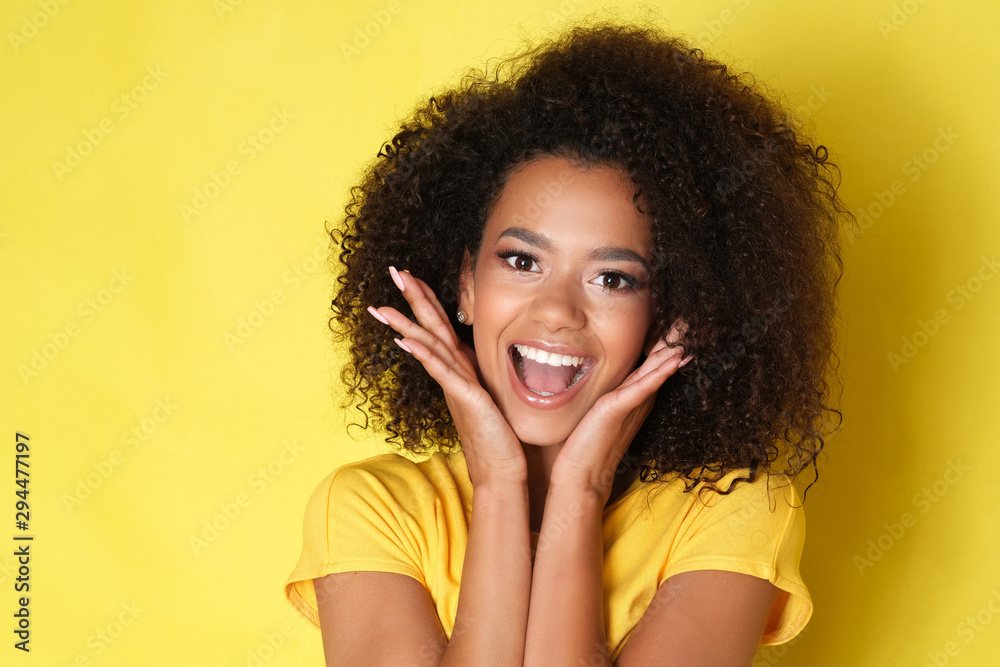 Fototapeta Beautiful smile from young happy model isolated on yellow background.
