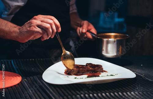 Valokuvatapetti Professional chef serving food on plates