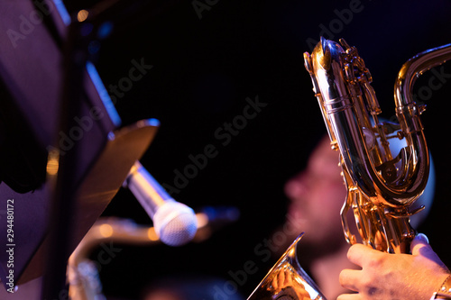 A musician playing a baritone saxophone in a big band saxophone section with the Canvas Print