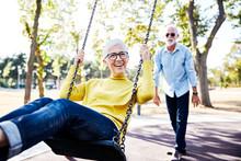 Senior Couple Happy Swing Park...