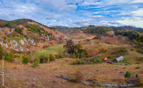 Foto op Plexiglas Zandwoestijn Autumn hills and trees with blue sky and sunlight. Colorful autumn landscape in the mountain. Autumn mountain panorama.