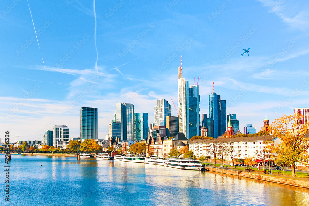 Fototapeta Skyline cityscape of Frankfurt, Germany during sunny day with a plane. Frankfurt am Main is a financial capital of Europe.