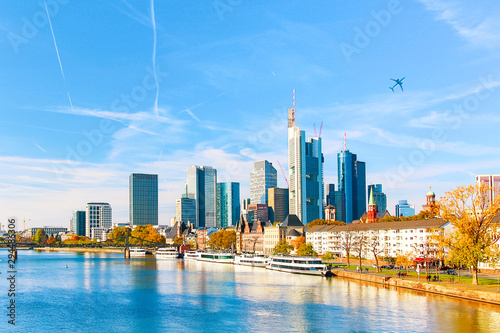 Obraz Skyline cityscape of Frankfurt, Germany during sunny day with a plane. Frankfurt am Main is a financial capital of Europe. - fototapety do salonu