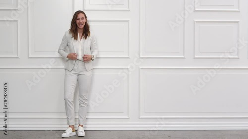 Laughing Businesswoman In White