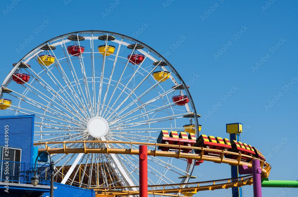 Fototapety, obrazy: Amusement park scene of a ferris wheel and roller coaster