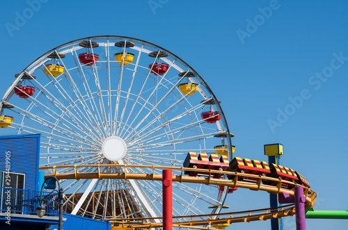 Garden Poster Amusement Park Amusement park scene of a ferris wheel and roller coaster