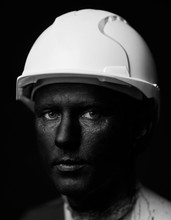 Coal And Oil Miner, Dirty Worker Against Dark Background, Close-up