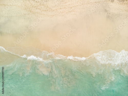 aerial drone shot, Top view of beautiful white sand beach with turquoise sea water and palm trees,